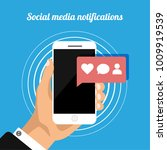 hand holds phone with social... | Shutterstock .eps vector #1009919539