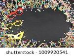 carnival frame with confetti... | Shutterstock . vector #1009920541