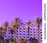 tropical purple mood. palms.... | Shutterstock . vector #1009926205