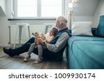 elderly man holding his... | Shutterstock . vector #1009930174