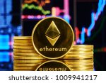 gold coin ethereum stacked on a ...   Shutterstock . vector #1009941217