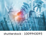 scientist or doctor dropping a... | Shutterstock . vector #1009943095