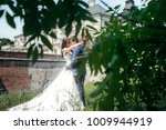 adorable happy newlywed couple... | Shutterstock . vector #1009944919