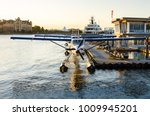 Row Of Seaplanes Moored To A...