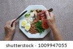 brazilian food dish   hands... | Shutterstock . vector #1009947055