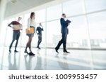 full length of group of happy... | Shutterstock . vector #1009953457