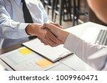 business partnership meeting... | Shutterstock . vector #1009960471