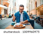 handsome modern freelancer... | Shutterstock . vector #1009960975