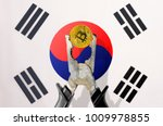 bitcoin coin being squeezed in... | Shutterstock . vector #1009978855