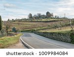 european country road. turn... | Shutterstock . vector #1009984084