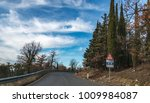 european country road. turn... | Shutterstock . vector #1009984087