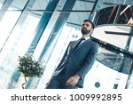 businessman in a fromal suit in ... | Shutterstock . vector #1009992895
