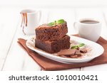 chocolate brownie square pieces ... | Shutterstock . vector #1010010421