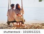 couple on beach holidays ... | Shutterstock . vector #1010012221