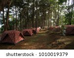 pile of camping tents at the... | Shutterstock . vector #1010019379