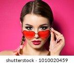 young beautiful playful woman... | Shutterstock . vector #1010020459