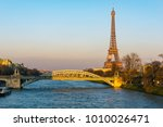 sunset on eiffel tower and pont ... | Shutterstock . vector #1010026471