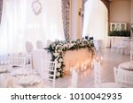 wedding. banquet. the chairs... | Shutterstock . vector #1010042935
