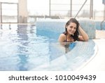 pretty woman at the pool  | Shutterstock . vector #1010049439