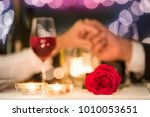 couple holding hands on a... | Shutterstock . vector #1010053651