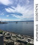 Small photo of Summer photo of Lake Champlain shot in Burlington, Vermont looking out to the Adirondack Mountains.