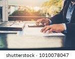 a businessman using a... | Shutterstock . vector #1010078047