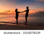 Silhouette Of Couple On The...