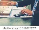 a businessman analyzing... | Shutterstock . vector #1010078269