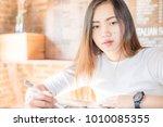 pretty asian student women... | Shutterstock . vector #1010085355