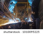 worker with protective mask... | Shutterstock . vector #1010095225