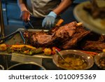 closeup chef with knife... | Shutterstock . vector #1010095369