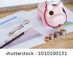 pink piggy bank with coins on... | Shutterstock . vector #1010100151