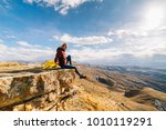 woman tourist sits on the...   Shutterstock . vector #1010119291