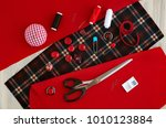 sew of red and checkered fabric.... | Shutterstock . vector #1010123884