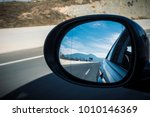 left mirror car on a highway on ...   Shutterstock . vector #1010146369