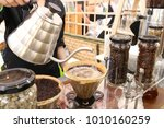 coffee through filter paper by... | Shutterstock . vector #1010160259