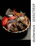 Small photo of Shellfish plate of crustacean seafood with fresh fish, mussels, oysters as an ocean gourmet dinner background