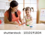 mom with creative child... | Shutterstock . vector #1010191834