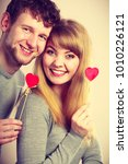 Small photo of Romance feelings youth emotions relationship concept. Youthful couple holding hearts. Girl with boy showing love symbols on sticks.
