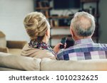 elderly couple watching... | Shutterstock . vector #1010232625
