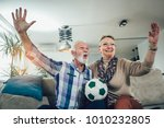 happy senior couple watching... | Shutterstock . vector #1010232805