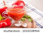 tomato sauce in a glass gravy...   Shutterstock . vector #1010238964