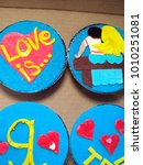 Small photo of cupcakes custom decorated with fondant in the style of love is