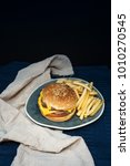 Small photo of Cheese burger - American cheese burger with Golden French fries