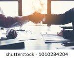 business partners handshaking... | Shutterstock . vector #1010284204
