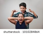 angry elder brother attcks his... | Shutterstock . vector #1010284864