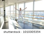 male barefoot dancer jumping... | Shutterstock . vector #1010305354