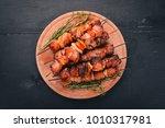 shish kebab on skewers with... | Shutterstock . vector #1010317981
