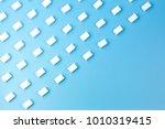 white sugar cubes arranged in... | Shutterstock . vector #1010319415