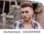 attractive guy with the plaid... | Shutterstock . vector #1010344405